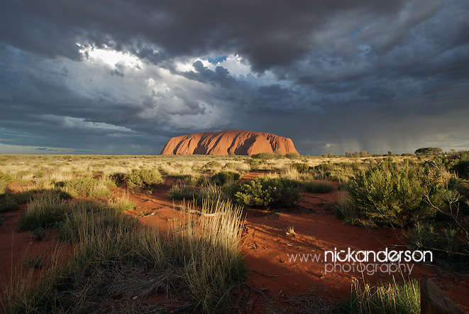 Uluru/Ayers Rock illuminated at sunset, as a dramatic storm passes overhead (Nick Anderson)