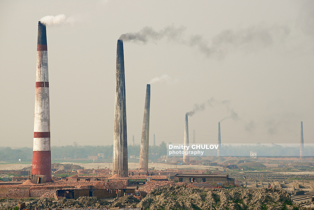 Polluting air brick factories pipes at Dhakka, Bangladesh. Low quality brick is the only available construction material for people in Bangladesh. Bangladesh has about 400 000 small private brick factories. (Dmitry Chulov)