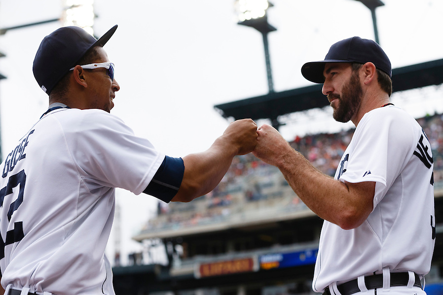 Jun 13, 2015; Detroit, MI, USA; Detroit Tigers center fielder Anthony Gose (12) receives congratulations from starting pitcher Justin Verlander (35) after making a diving catch of a ball hit by Cleveland Indians left fielder Michael Brantley (not pictured) in the first inning at Comerica Park. Mandatory Credit: Rick Osentoski-USA TODAY Sports (Rick Osentoski/Rick Osentoski-USA TODAY Sports)