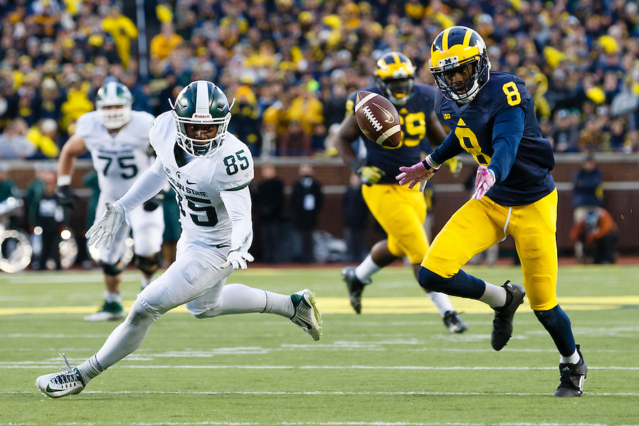 Oct 17, 2015; Ann Arbor, MI, USA; Michigan Wolverines cornerback Channing Stribling (8) and Michigan State Spartans wide receiver Macgarrett Kings Jr. (85) can't get to the pass at Michigan Stadium. Mandatory Credit: Rick Osentoski-USA TODAY Sports (Rick Osentoski/Rick Osentoski-USA TODAY Sports)