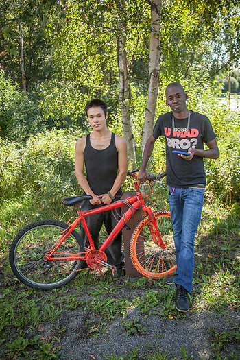 "Omar Joseph and Torrell Ridge stop to repair their bicycle on 15th Terrace in Anchorage.  ""I leave Friday for a fish processing job in Atka.  I won't return until November 15th.""  -Torrell Ridge.   omarjoseph68@yahoo.com  ridgetorrell@gmail.com (© Clark James Mishler)"