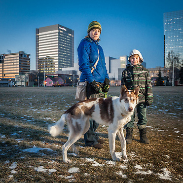 Kelly Janukajtis, her son, Jackson (8), and their dog, Swiss, on the Delaney Park Strip, Anchorage, Alaska (Clark James Mishler)