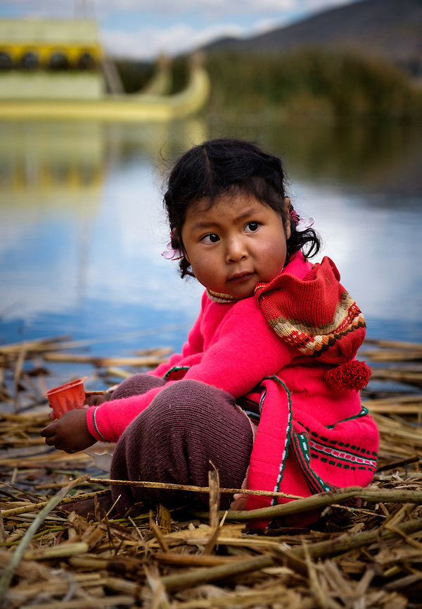 UROS ISLANDS, PERU - CIRCA October 2015: Girl from the Uros Islands in Lake Titicaca. (Daniel Korzeniewski)
