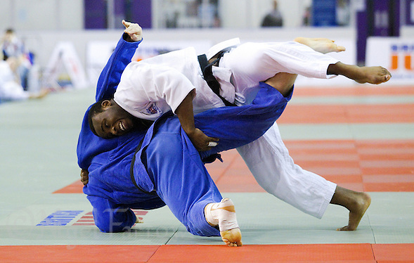 27 MAR 2011 - SHEFFIELD, GBR - Theodore Spalding-Mcintosh (white) throws Boris Kibrik (blue) to score ippon and win the men's under 100kg category at the English Senior Open Judo Championships (PHOTO (C) NIGEL FARROW) (NIGEL FARROW/(C) 2011 NIGEL FARROW)