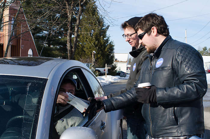 2016-02-06-Manchester, NH-Members of Tufts for Bernie canvass in Manchester, NH on Sunday February 6th before the state primary on Tuesday. Nate Krinsky (center) and Zach Bernstein (right) get more Bernie literature from Nick Nasser (left), another Tufts for Bernie member (Alex Knapp / The Tufts Daily) (Alex Knapp)