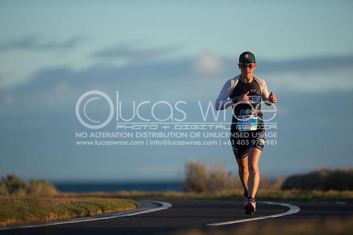 Age Group Competitors - Afternoon Sunset, March 23, 2014 - Ironman Triathlon : Ironman Melbourne Race, Run Course, St Kilda, Melbourne, Victoria, Australia. Credit: Lucas Wroe (Lucas Wroe)
