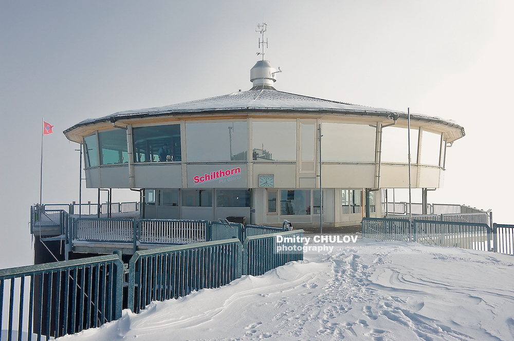 Piz Gloria restaurant at Schilthorn. Schilthorn is a 2,970 metre high summit in the Bernese Alps in Switzerland, above Mürren. It has a panorama, which spans from the Titlis, Jungfrau, Mönch, Eiger, over the Bernese Alps and the Jura mountains up to the Vosges Mountains and the Black Forest. Mont Blanc is also just visible. A series of four cable cars, known as the Luftseilbahn Stechelberg-Mürren-Schilthorn (LSMS), provides transportation from Mürren downhill to Gimmelwald and Stechelberg, and uphill to the summit of the Schilthorn and the revolving restaurant Piz Gloria. This was a principal filming location for the James Bond movie On Her Majesty's Secret Service, released in 1969. To get to the Schilthorn from the valley floor either of a series of cable cars must be taken. The cable cars begin in Stechelberg leaving to Gimmelwald and then onto Mürren. From Mürren another cable car is taken to Birg, which is the final change before the Schilthorn. The other way up is to take the cable car from Lauterbrunnen to Grütschalp and a train to Muerren, from where the cable car must be taken. Between Birg and the summit, the cable car passes over Grauseeli, a small lake. It is also possible to hike to the peak, along the myriad of small, but well-marked paths to the top. The hike to the top takes roughly 5 hours from Gimmelwald for an experienced hiker. There is a panoramic revolving restaurant, named Piz Gloria, at the summit, which is where the James Bond movie On Her Majesty's Secret Service was set. A famous black ski run featured in the film starts at the summit and leads down to the Engetal below Birg. The restaurant revolves a full 360 degrees in 55 minutes. (Dmitry Chulov)