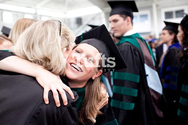 05/22/2011- Medford, Mass. - Eliza Bullis, M11, hugs a friend after commencement for the Tufts University School of Medicine on May 22, 2011. (Kelvin Ma/Tufts University) (Kelvin Ma/Tufts University)