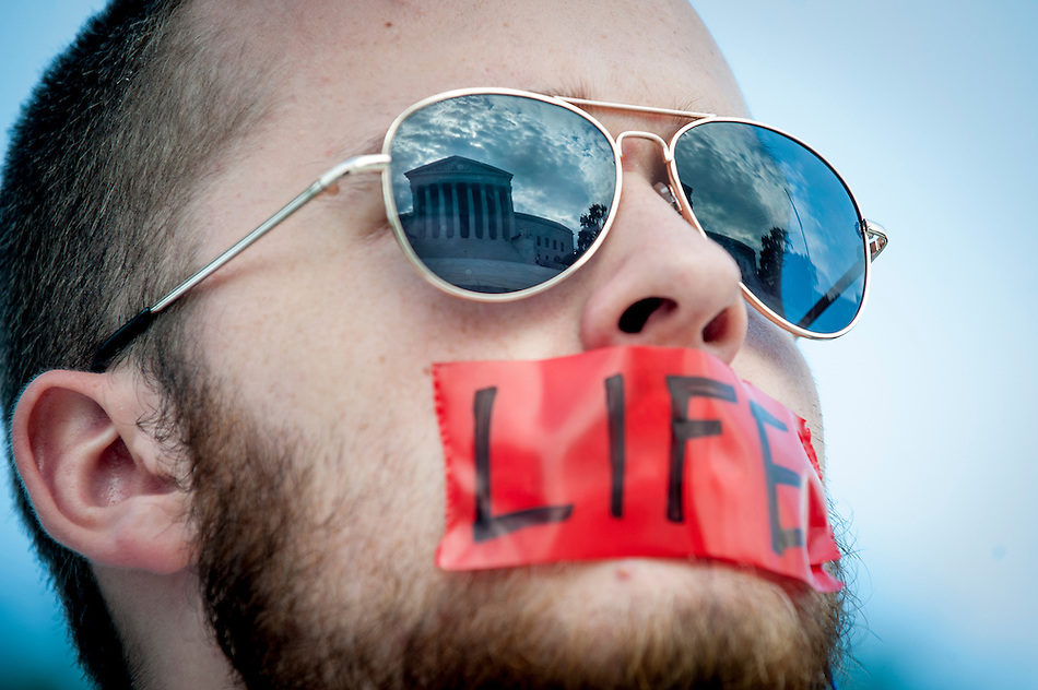 Seth Hansen, 18, of Pensacola, FL, stands vigil outside of the Supreme Court  in Washington, District of Columbia, U.S., on Monday, June 30, 2014 as the Court prepares to hand down its ruling on whether Obamacare can mandate contraception coverage specifically for certain businesses that object for religious reasons. (Pete Marovich/Bloomberg)