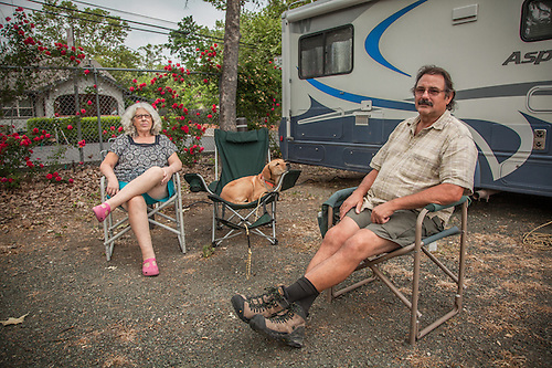 "Centralia ,Washington residents Angie and Earl Neuert with their dog, Summer, at the Calistoga RV Park. ""We just spent the winter down south...Florida, Alabama, Arkansas...but we liked Texas the best...they had the lowest cost of living."" -Earl Neuert (Clark James Mishler)"