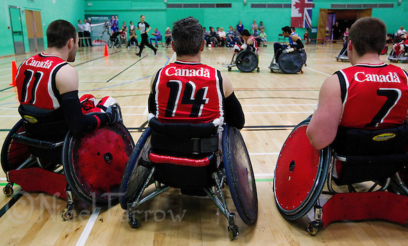 15 AUG 2011 - LEEDS, GBR - Canadian squad members wait on the sideline for a chance to play during the wheelchair rugby exhibition match between Great Britain and Canada .(PHOTO (C) NIGEL FARROW) (NIGEL FARROW/(C) 2011 NIGEL FARROW)