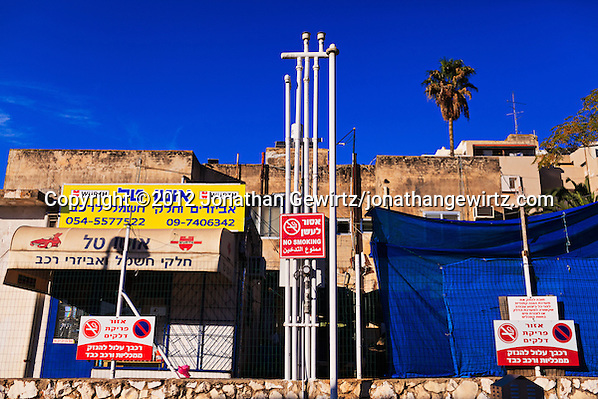Vent pipes and signs on edge of a gas station parking area in Hod Hasharon, Israel. (© 2012 Jonathan Gewirtz / jonathan@gewirtz.net)