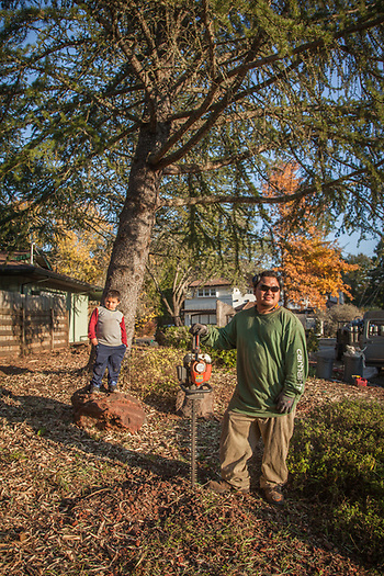"""Simply Landscapes owner Tony Dang with his six year old son, Noah, at a work site on School Street in Calistoga, California.  """"I've been working as a landscaper since I was ten years old...my son is off school this week, so I thought I would bring him along.""""  generallandscapes@gmail.com (© Clark James Mishler)"""