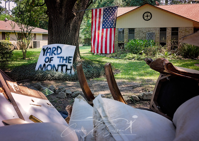 "A ""Yard of the Month"" sign, nearly obscured by flood debris, leans against a tree, Sept. 6, 2017, in Houston, Texas. Houston received nearly 52 inches of rain following Hurricane Harvey, resulting in heavy flooding. This was the third time for this home to be flooded, and the homeowner said she does not plan to stay this time. (Photo by Carmen K. Sisson/Cloudybright) (Carmen K. Sisson/Cloudybright)"