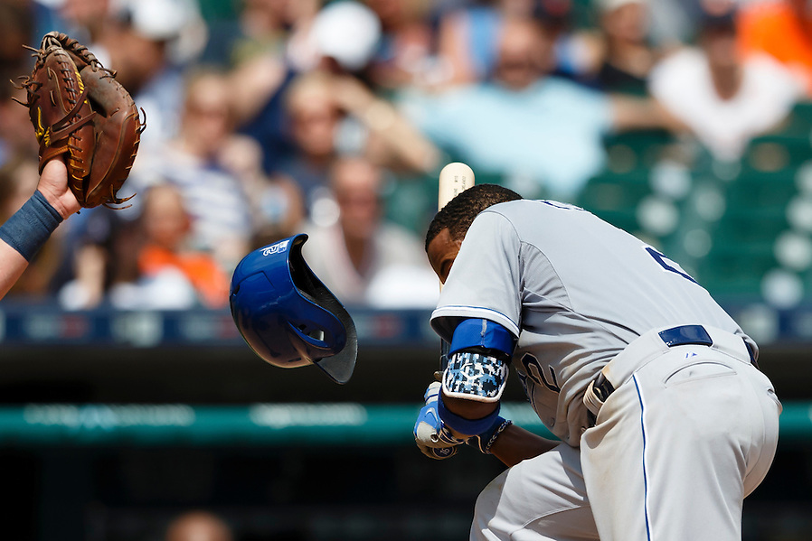 May 9, 2015; Detroit, MI, USA; Kansas City Royals shortstop Alcides Escobar (2) reacts to an inside pit in the eighth inning against the Detroit Tigers at Comerica Park. Mandatory Credit: Rick Osentoski-USA TODAY Sports (Rick Osentoski/Rick Osentoski-USA TODAY Sports)