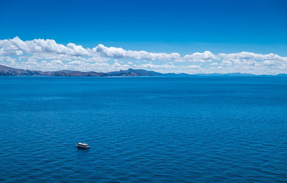 View of lake Titicaca in Peru with typical tourist boat. (Daniel Korzeniewski)