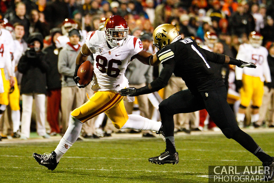 November 23rd, 2013:  USC Trojans junior tight end Xavier Grimble (86) attempts to get past Colorado Buffaloes senior inside linebacker Derrick Webb (1) in first quarter action of the NCAA Football game between the University of Southern California Trojans and the University of Colorado Buffaloes at Folsom Field in Boulder, Colorado (Carl Auer/ZUMAPRESS.com)