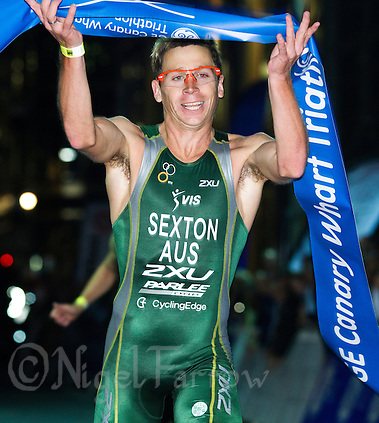 30 JUN 2011 - LONDON, GBR - Brendan Sexton celebrates winning the men's super sprint final at the GE Canary Wharf Triathlon .(PHOTO (C) NIGEL FARROW) (NIGEL FARROW/(C) 2011 NIGEL FARROW)
