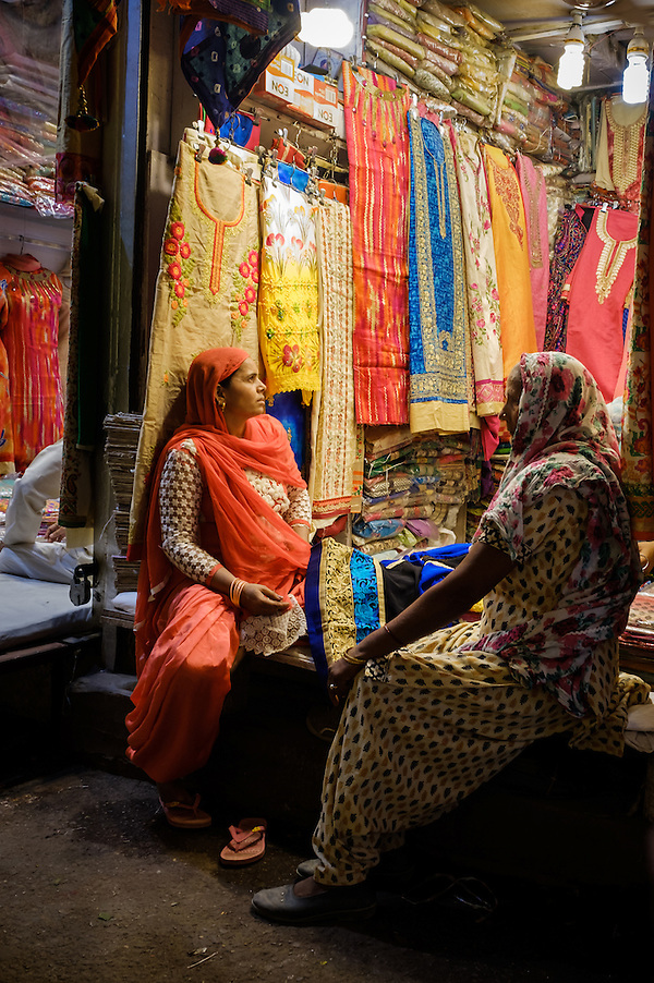 NEW DELHI, INDIA - CIRCA OCTOBER 2016: Women shopping for Sarees in the street market of Delhi Chandni Chowk area in Old Delhi. (Daniel Korzeniewski)