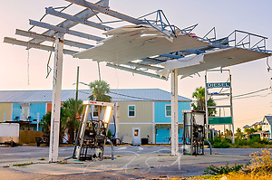 An Exxon gas station damaged by Hurricane Michael in 2018 remains standing, Sept. 27, 2019, in Mexico Beach, Florida. Most of the town's businesses were damaged or destroyed by the category five hurricane, and many homeowners remain in limbo as they wait for money from their insurance companies or the Federal Emergency Management Agency to pay for repairs or demolition. (Photo by Carmen K. Sisson/Cloudybright) (Carmen K. Sisson/Cloudybright)