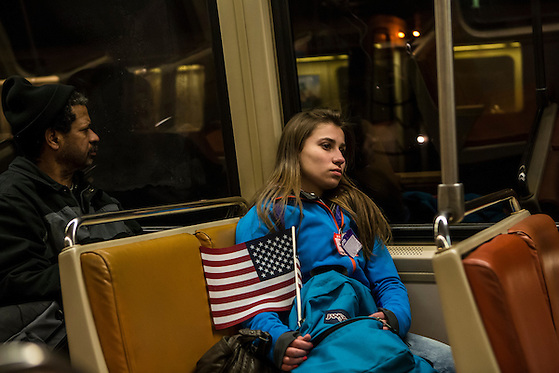 A woman rides the metro back from President Barack Obama's Inauguration on Monday, January 21, 2013 in Washington, DC. (Brendan Hoffman/Brendan Hoffman for the New York Times)