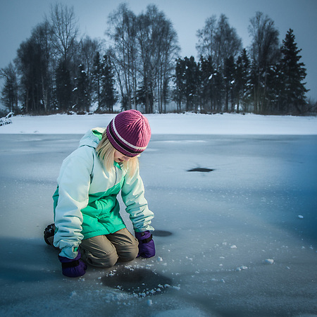 Sarah ponders the new ice at Cuddy Park in Anchorage's mid town (Clark James Mishler)