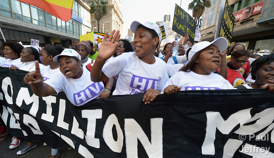 Demonstrators sing and chant as they march through the streets of Durban, South Africa, demanding better funding for HIV and AIDS treatment around the world. The demonstration took place on the first day of the 2016 International AIDS Conference in Durban. (Paul Jeffrey)