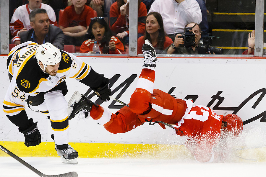 Apr 2, 2015; Detroit, MI, USA; Detroit Red Wings center Darren Helm (43) is up ended by Boston Bruins defenseman Adam McQuaid (54) in the third period at Joe Louis Arena. Boston won 3-2. Mandatory Credit: Rick Osentoski-USA TODAY Sports (Rick Osentoski/Rick Osentoski-USA TODAY Sports)