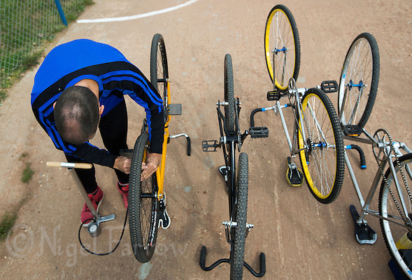 13 SEP 2014 - IPSWICH, GBR - Stuart Gedge of Kesgrave Panthers checks the tyre pressures on his bike before the start of the 2014 British Open Club Cycle Speedway Championships at Whitton, Ipswich in Great Britain (PHOTO COPYRIGHT © 2014 NIGEL FARROW, ALL RIGHTS RESERVED) (NIGEL FARROW/COPYRIGHT © 2014 NIGEL FARROW : www.nigelfarrow.com)