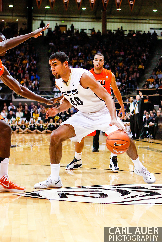 January 2nd, 2014:  Colorado Buffaloes sophomore forward Josh Scott (40) dribbles the basketball in the first half of action in the NCAA Basketball game between the Oregon State Beavers and the University of Colorado Buffaloes at the Coors Events Center in Boulder, Colorado (Carl Auer/ZUMAPRESS.com)