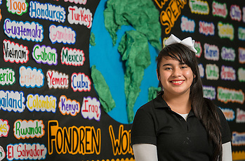 Daniela Fuentes poses for a photograph at Fondren Middle School, November 24, 2014. Fuentes, of El Salvador, received the City of Houston Citizenship Month Literary Award for a poem she wrote. (Houston ISD/Dave Einsel)