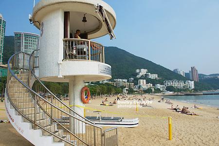 HONG KONG, CHINA - SEPTEMBER 16, 2012: Unidentified life guard on duty at Stanley town beach in Hong Kong, China. Stanley town is a tourist attraction in Hong Kong. (Dmitry Chulov)