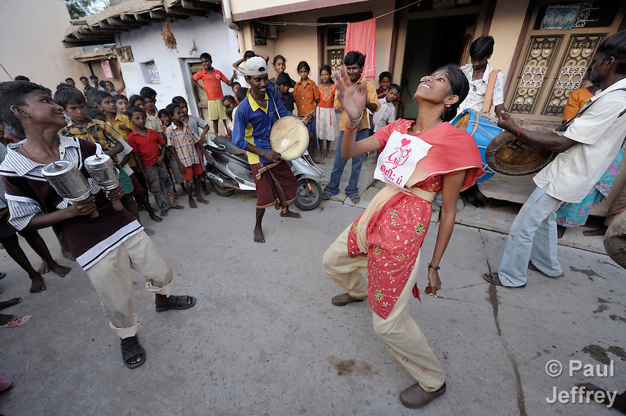 Accompanied by drummers, a young woman dances in the streets of Sathangudi, a rural Indian village, to invite residents to a play about HIV and AIDS. The group is sponsored by the Center for Research and Rehabilitation of Infants and Females (CRIF)--based in Madurai, Tamil Nadu--which conducts advocacy and education on HIV and AIDS. CRIF receives support from United Methodist Women Mission Giving.