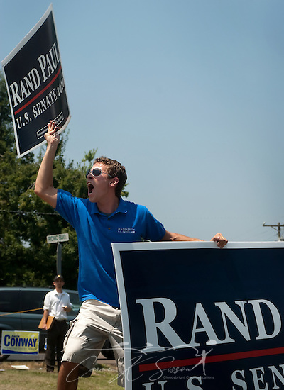 Lance Wheeler chants as he holds up signs supporting Republican Senate candidate Rand Paul Aug. 7, 2010 at the 130th annual Fancy Farm picnic and political rally in Fancy Farm, Ky. Wheeler, who attends the University of Kentucky, is state youth coordinator for Paul's campaign. (Photo by Carmen K. Sisson/Cloudybright) (Carmen K. Sisson/Cloudybright)