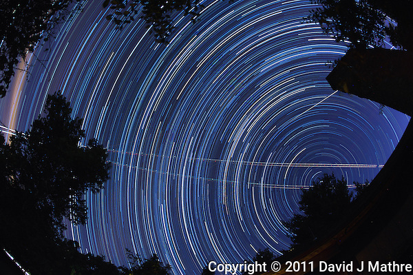 North View Star Trails. Summer Night in New Jersey. Image taken with a Nikon D3s and 16 mm f/2.8 mm Fisheye lens (ISO 800, 16 mm, f/5.6, 30 sec). Composite of 326 images combined using the Startrails program. (David J Mathre)