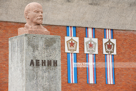 PYRAMIDEN, NORWAY - SEPTEMBER 03, 2011: Exterior of the bust of Lenin at the abandoned Russian arctic settlement Pyramiden, Norway. (Dmitry Chulov)