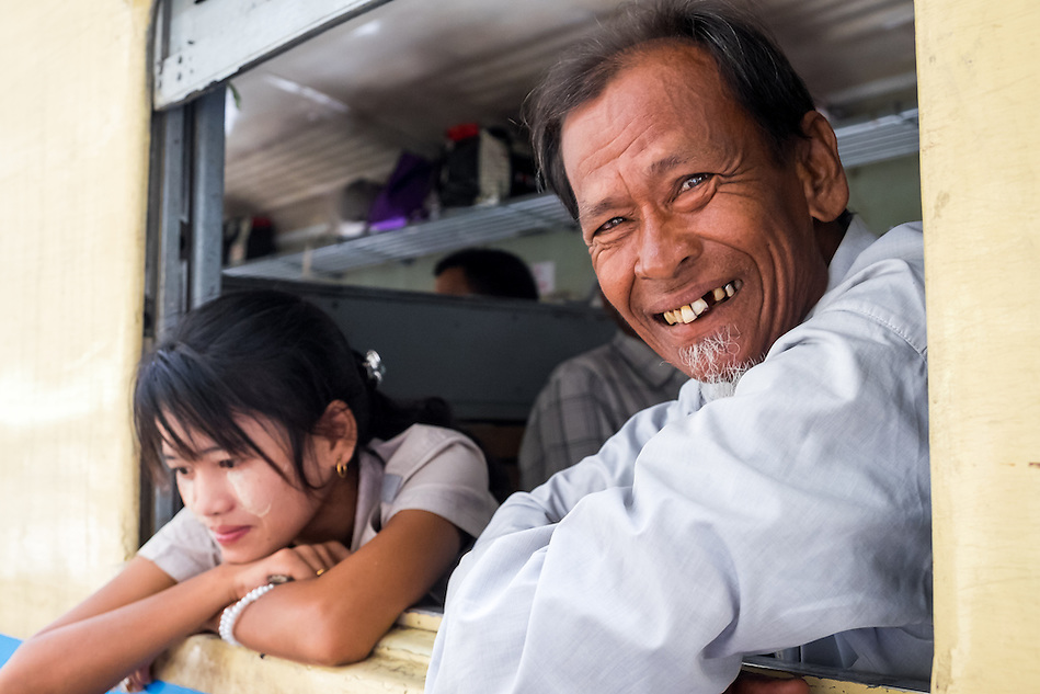 YANGON, MYANMAR - CIRCA DECEMBER 2013: Happy passenger smiles in the Yangon Central Railway Station (Daniel Korzeniewski)