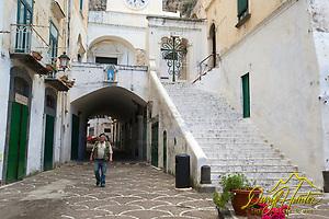 Alfonso an Italian artist in courtyard in Atrani Italy