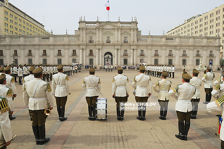 SANTIAGO, CHILE - OCTOBER 18, 2013: Unidentified military of the Carabineros band attend changing guard ceremony in front of the La Moneda presidential palace in Santiago, Chile. (Dmitry Chulov)