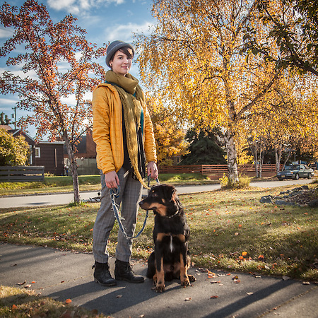 Fire Island Bakery Scone baker Claire Lubke with her employer's six month old dog, Oden, in Anchorage's South Addition neighborhood. (© Clark James Mishler)