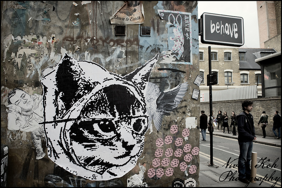 Catface sticker on a Shoreditch wall, East London (Viveca Koh)