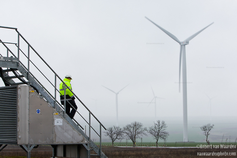 Miklos Szilagyi descends the stairs of a turbine on the Fantanele-Cogealac wind farm in Romania. (Robert van Waarden)