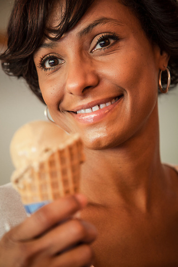 Young woman with coffee ice cream cone, Keokea Kealia, Hawaii (Clark James Mishler)