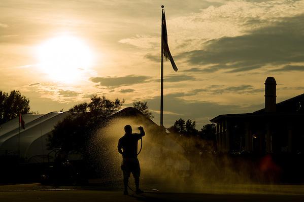 A member of the maintenance staff hand waters a green during a practice round before the 2014 U.S. Open at Pinehurst Resort & C.C. in Village of Pinehurst, N.C. on Monday, June 9, 2014.   (Copyright USGA/Darren Carroll) (Darren Carroll/USGA Museum)
