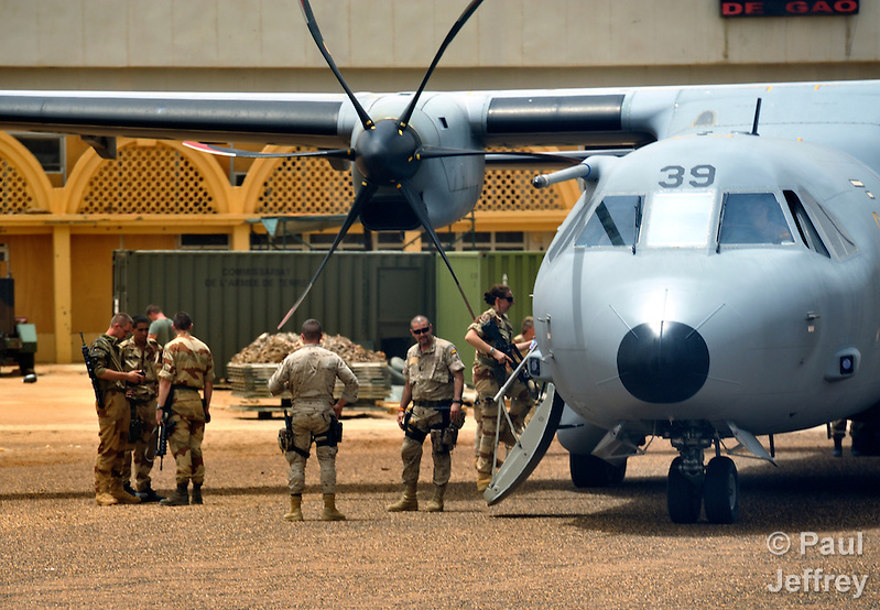 French soldiers board a plane in the airport in Gao, a northern Mali city that was seized by Islamist fighters in 2012 and then liberated by French and Malian soldiers in early 2013. (Paul Jeffrey)