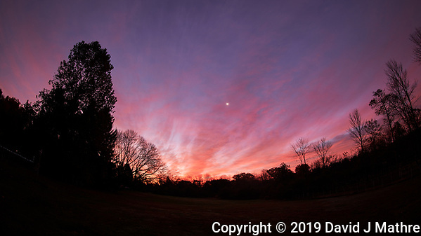 Colorful clouds and waning crescent moon at dawn. Image taken with a Nikon D850 camera and 8-15 mm fisheye lens (ISO 64, 15 mm, f/5.6, 5 sec). (DAVID J MATHRE)