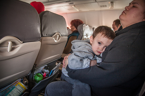 Two year old Alaska Airlines seat mate, Coltin, on flight to Seattle. (Clark James Mishler)