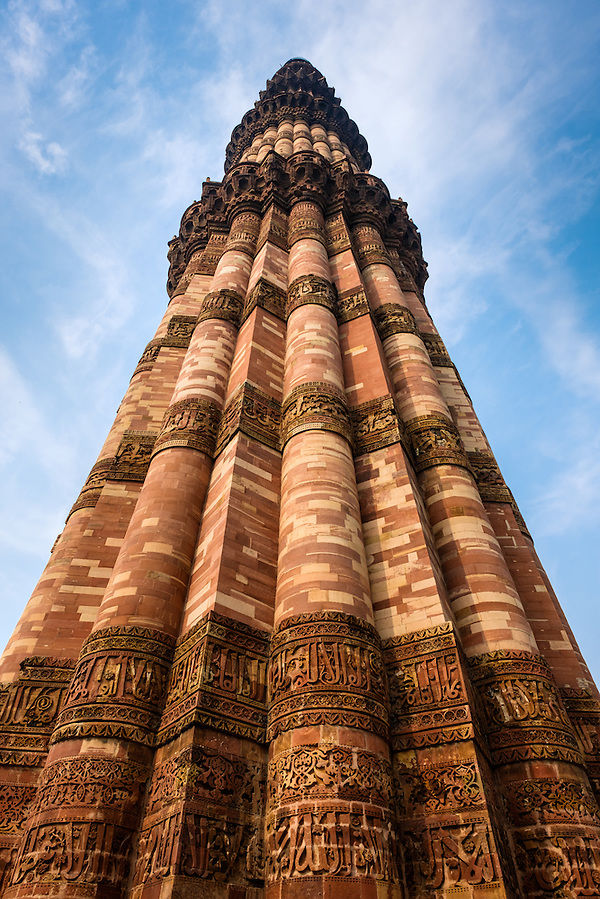 NEW DELHI, INDIA - CIRCA OCTOBER 2016: Minaret at the Qutub Minar complex. With 73 metres, is the tallest brick minaret in the world and second highest minar in India, a popular tourist attraction and Unesco World Heritage Site. (Daniel Korzeniewski)