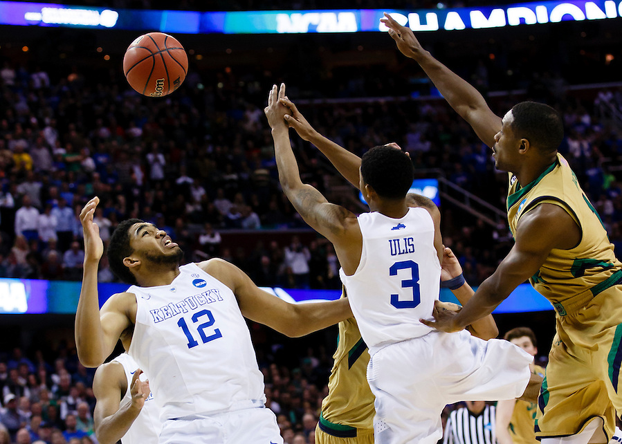 Mar 28, 2015; Cleveland, OH, USA; Kentucky Wildcats forward Karl-Anthony Towns (12) guard Tyler Ulis (3) and Notre Dame Fighting Irish guard Demetrius Jackson (11) goes for the rebound in the finals of the midwest regional of the 2015 NCAA Tournament at Quicken Loans Arena. Mandatory Credit: Rick Osentoski-USA TODAY Sports (Rick Osentoski/Rick Osentoski-USA TODAY Sports)