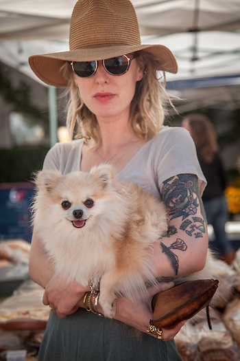 Calistoga barber Sarah Schaefer with her 2 year old Pomeranian, June, at the Calistoga Saturday Market (Clark James Mishler)